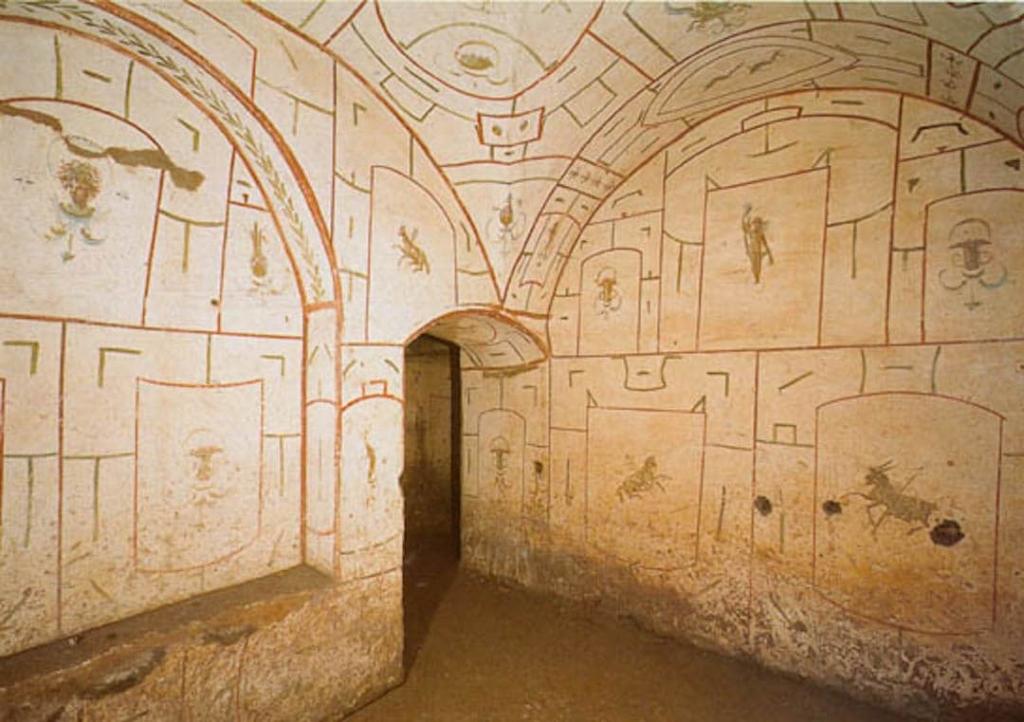 Intérieur des catacombes de Saint Sébastien. On voir les murs décorés de fresques très minimalistes.